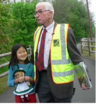 John Andrews at bridge dedictation with his granddaughter, Iulia, 6. (Staff photo by Kate Irish Collins)