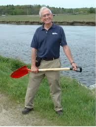 John Andrews holding a shovel